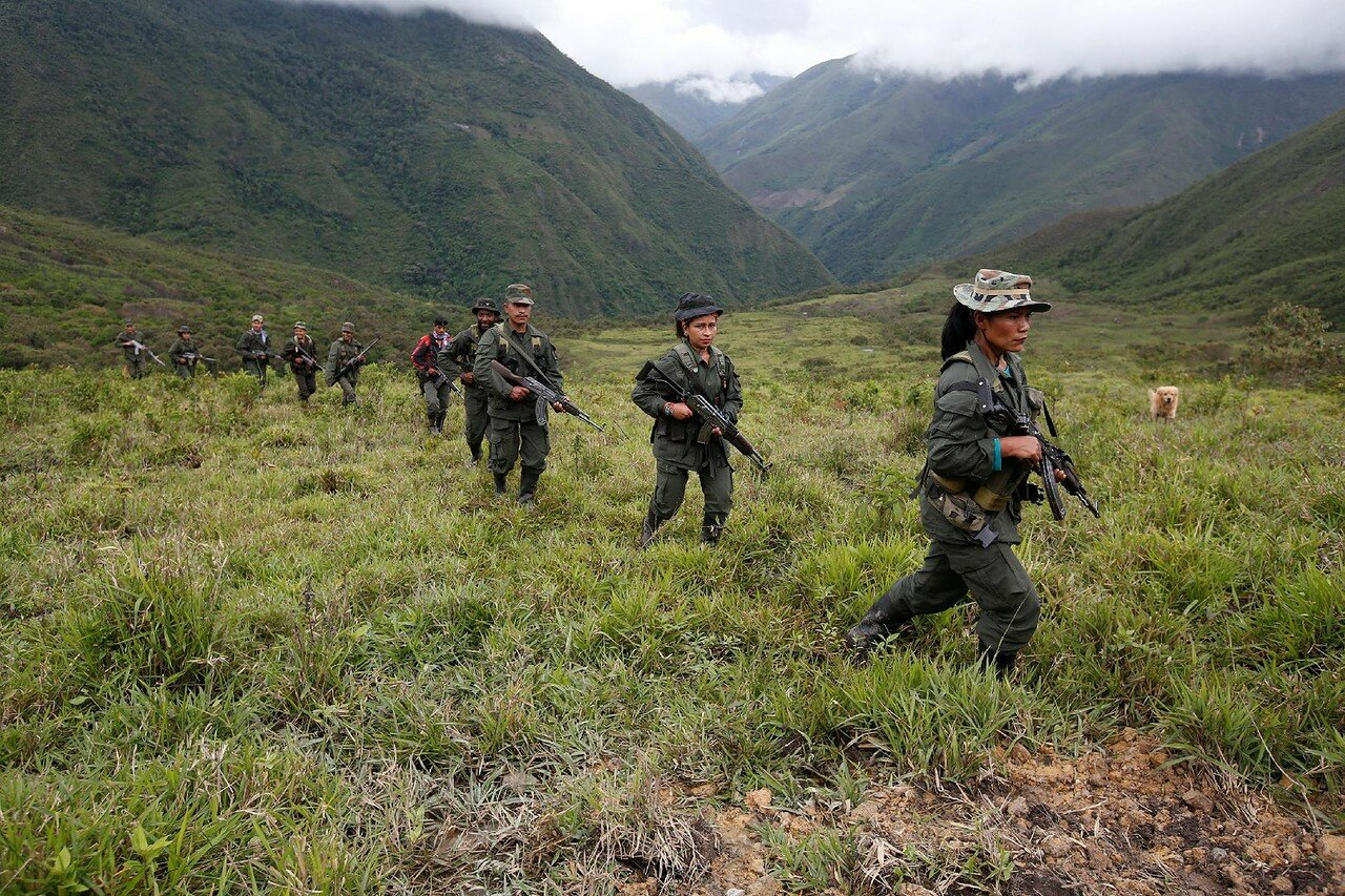 Members of the 51st Front of the Revolutionary Armed Forces of Colombia (FARC) patrol in the remote mountains of Colombia