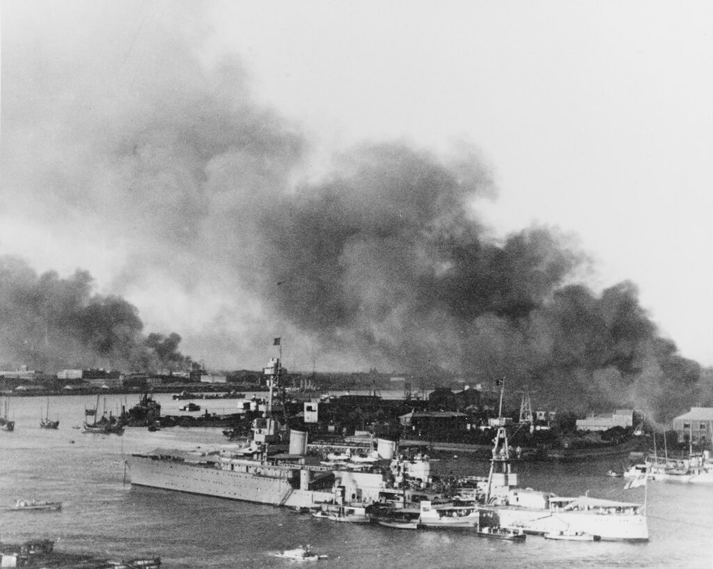 USS AUGUSTA (CA-31) Off Pootung Point, Shanghai, China, during hostilities there in 1937. Smoke is from burning cotton mills on the point.