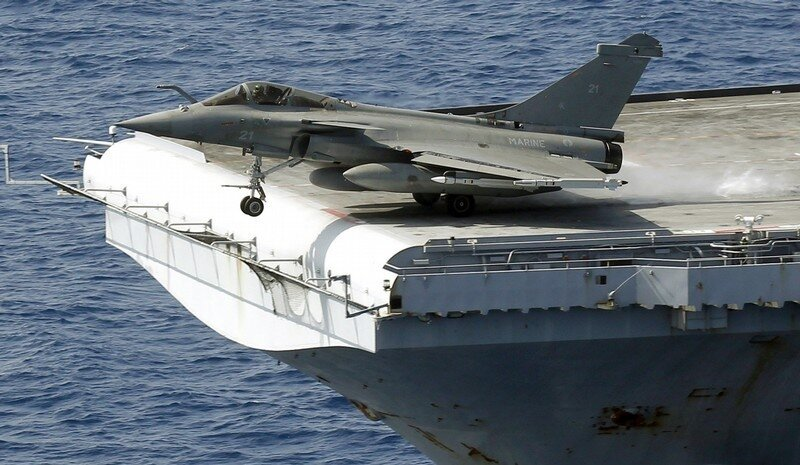 A Rafale fighter jet makes a catapult launch aboard France's flagship Charles de Gaulle aircraft carrier in the Mediterranean