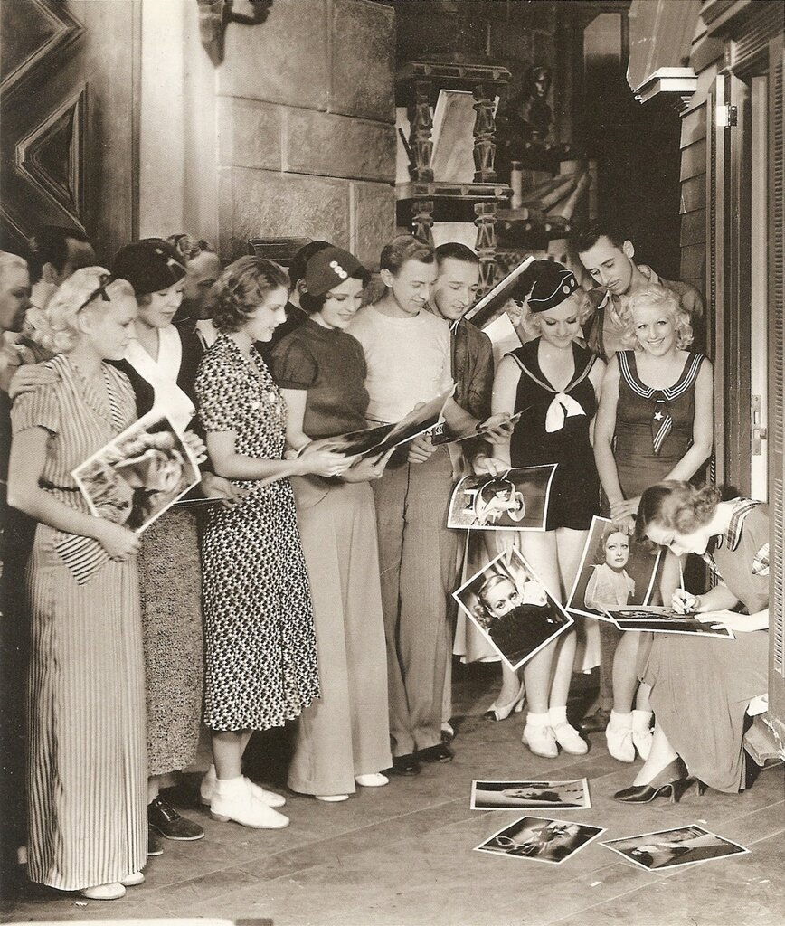 Joan Crawford signing autographs, 1933