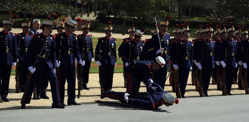 A soldier faints during the visit of the
