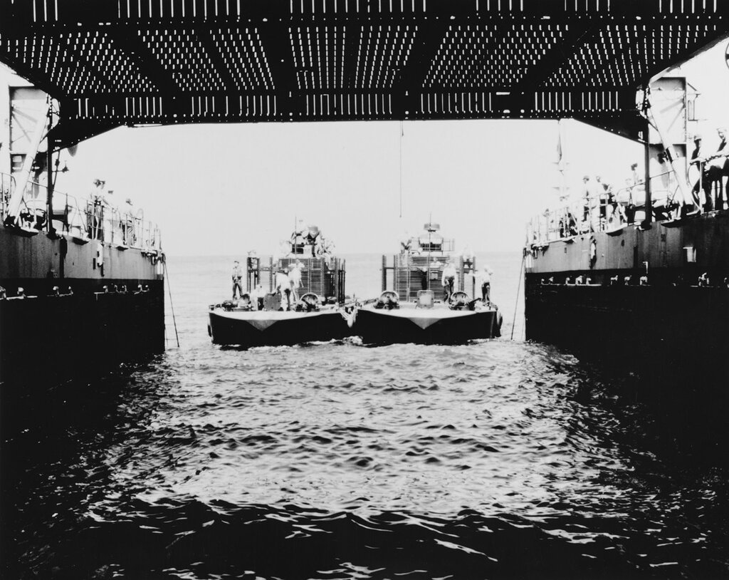 Two Monitor flame boats enter the well deck of the USS CATAMOUNT (LSD-17) after undergoing tests In San Diego Harbor, California. Tue, Aug 06, 1968