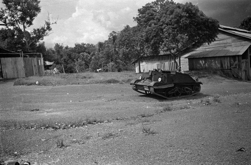 Malaysia_military_tank_driving_through_village.jpg