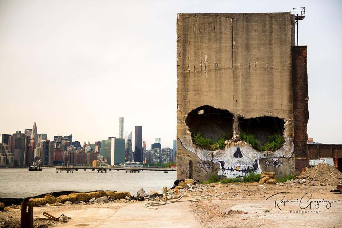 Skull Mural - A street artist turns an abandoned building into a giant skull