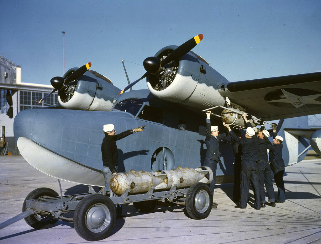 Grumman JRF-2 Goose having a depth charge placed under its right wing of the U. S. Coast Guard Hangar at Floyd Bennett Field, N.Y. ca. 1943.