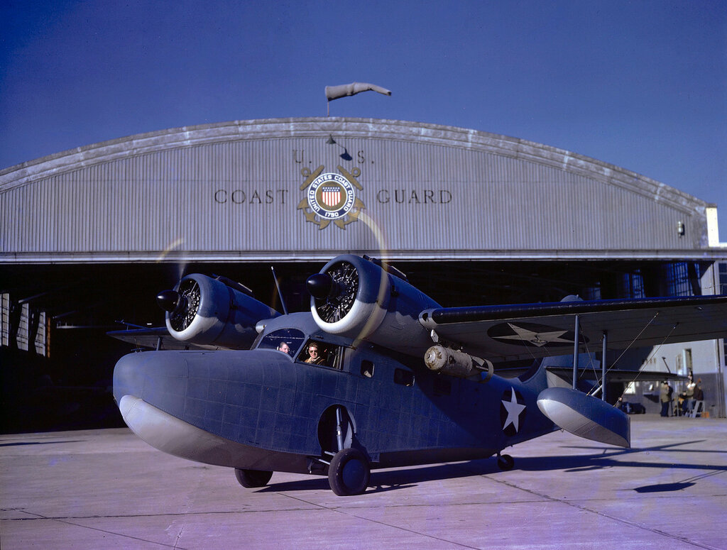 Grumman JRF-2 Goose aircraft on the ground with engines running in front of the US Coast Guard Hangar at Floyd Bennett Field, Long Island, New York, circa 1943.