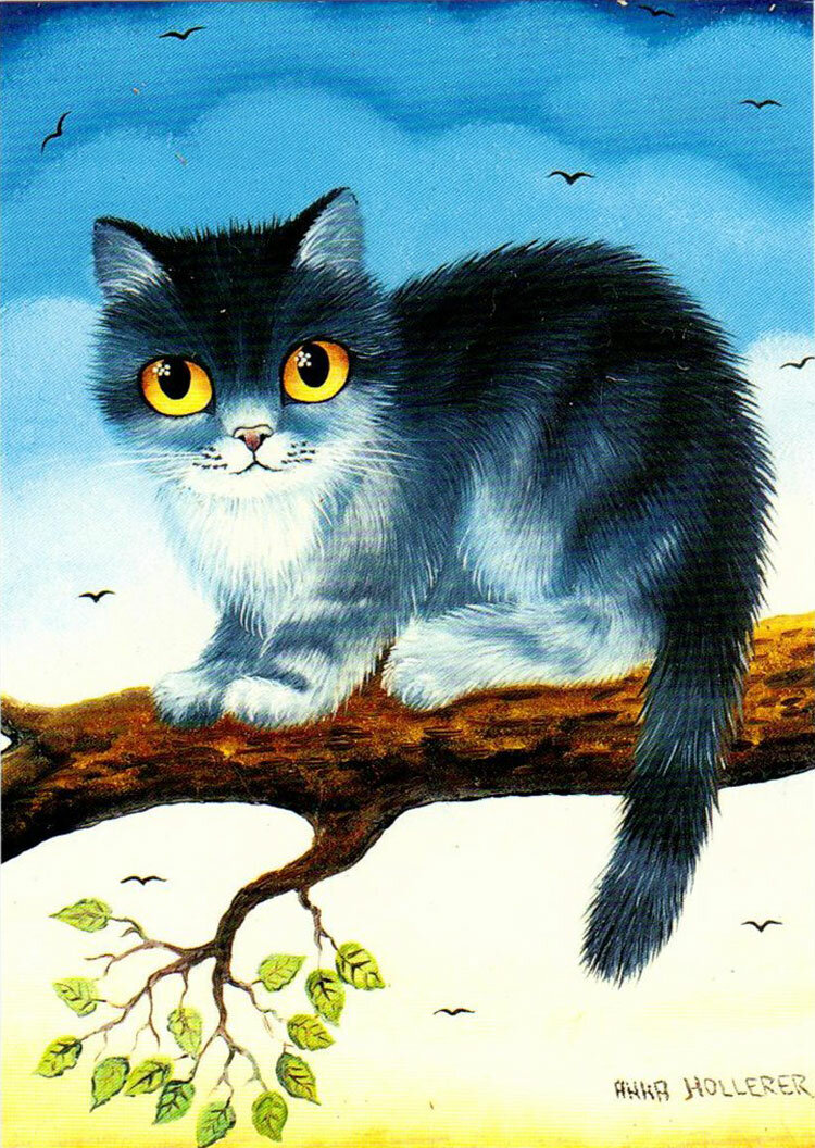 Кот на дереве.