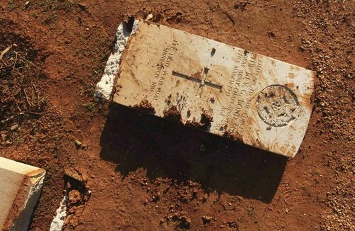 Gravestone is seen damaged by an Islamist group in protest at burning of Koran by U.S. soldiers in Afghanistan in Benghazi Military Cemetery