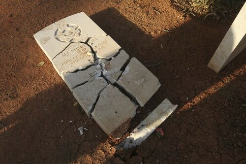 Gravestone is seen damaged by an Islamist group in protest at the burning of the Koran by U.S. soldiers in Afghanistan, in Benghazi Military Cemetery