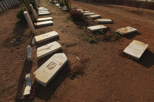 Gravestones are seen damaged by an Islamist group in protest at the burning of the Koran by U.S. soldiers in Afghanistan, in Benghazi Military Cemetery