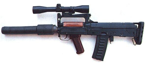 Автомат сохранил устройство АК-74 , но скомпонован по схеме булл-пап.  Подъем приклада.