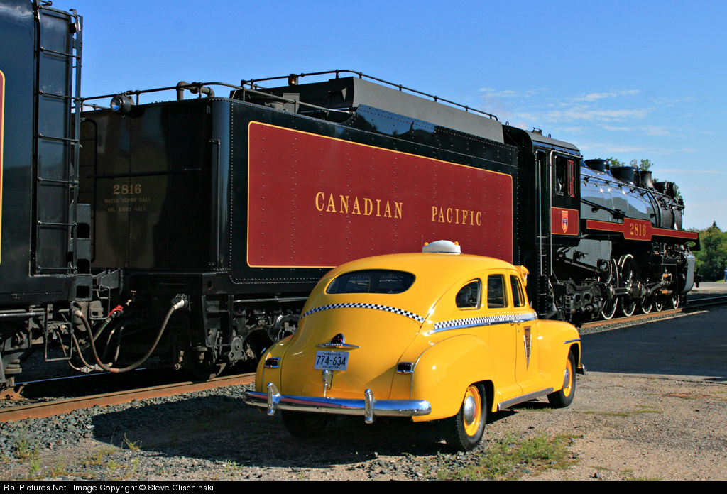 CP 2816 Canadian Pacific Railway and a vintage 1940s cab at the Soo Line depot in Thief River Falls, Minnesota, now the City Hall. The engine was en route from Calgary to Minneapolis. August 21, 2007