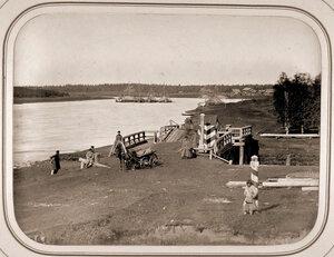 Вид моста через канал на реке Шексне.