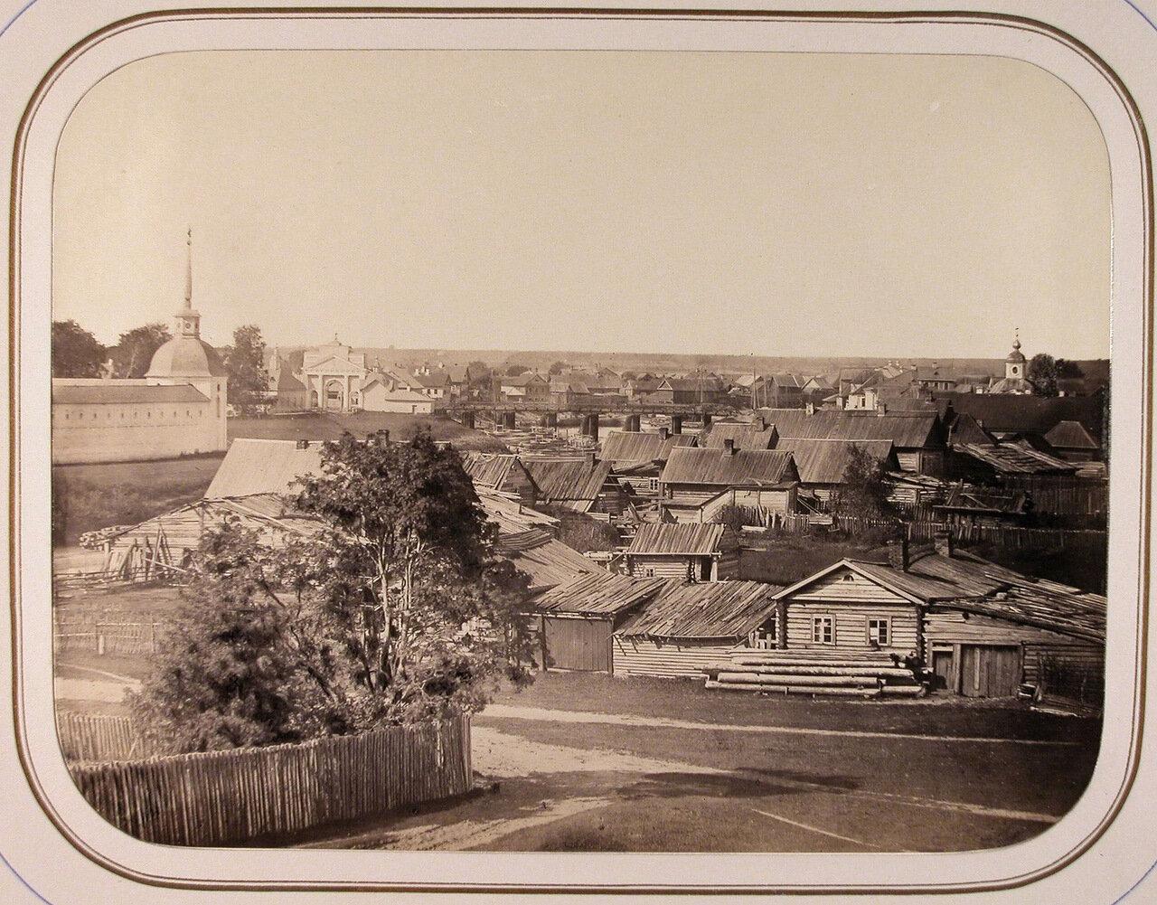 Вид жилых домов вблизи Успенского монастыря на реке Тихвинке (вид с кладбищенской горы)