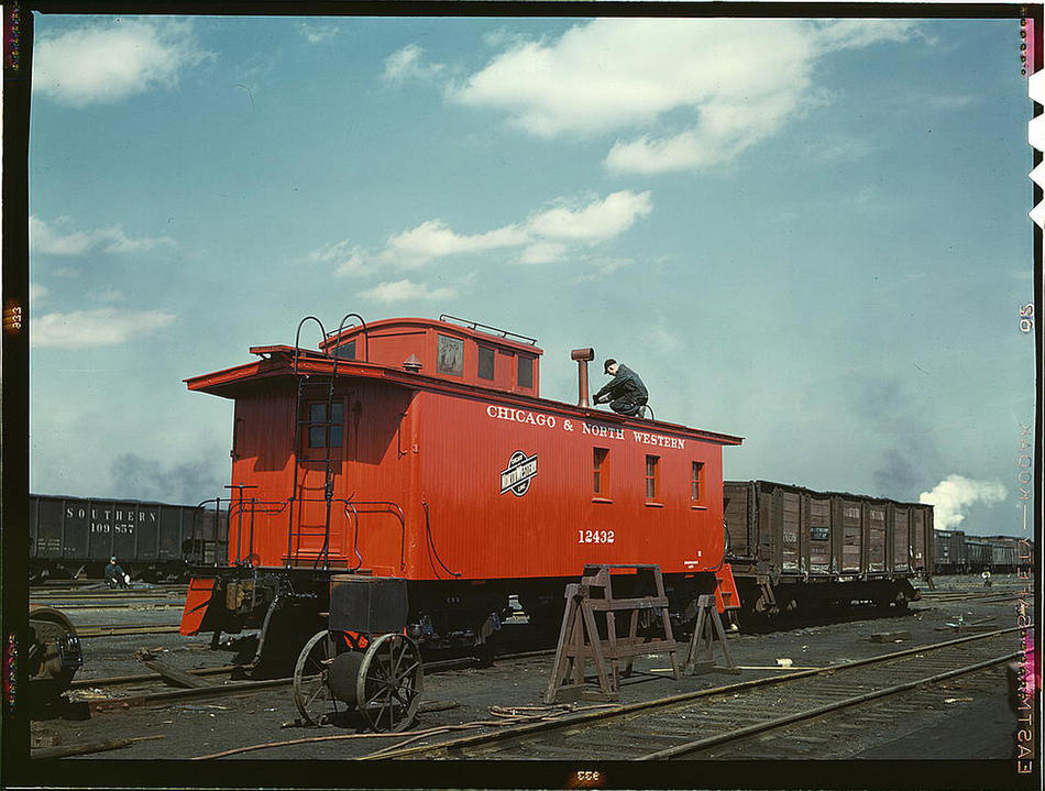 Putting the finishing touches on a rebuilt caboose at the rip tracks at Proviso yard. Chicago, Illinois, April 1943. Reproduction from color slide. Photo by Jack Delano. Prints and Photographs Division, Library of Congress