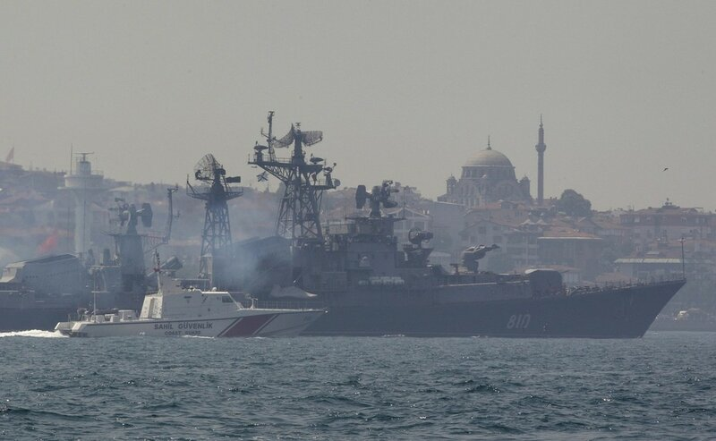 A Turkish Navy cost guard boat escorts the Russian Navy destroyer Smetlivy in the Bosphorus in Istanbul