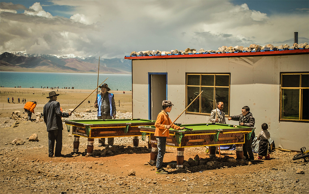 Vincent Cheng (Burnaby, Canada). Finalist: Travel. A group of locals playing billiards by Namtso Lak