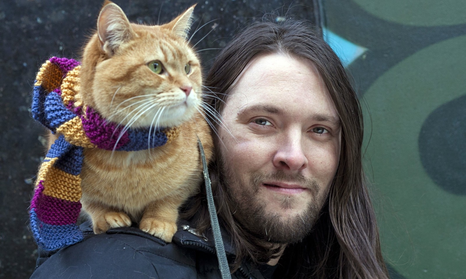 James Bowen, author, with Bob the street cat