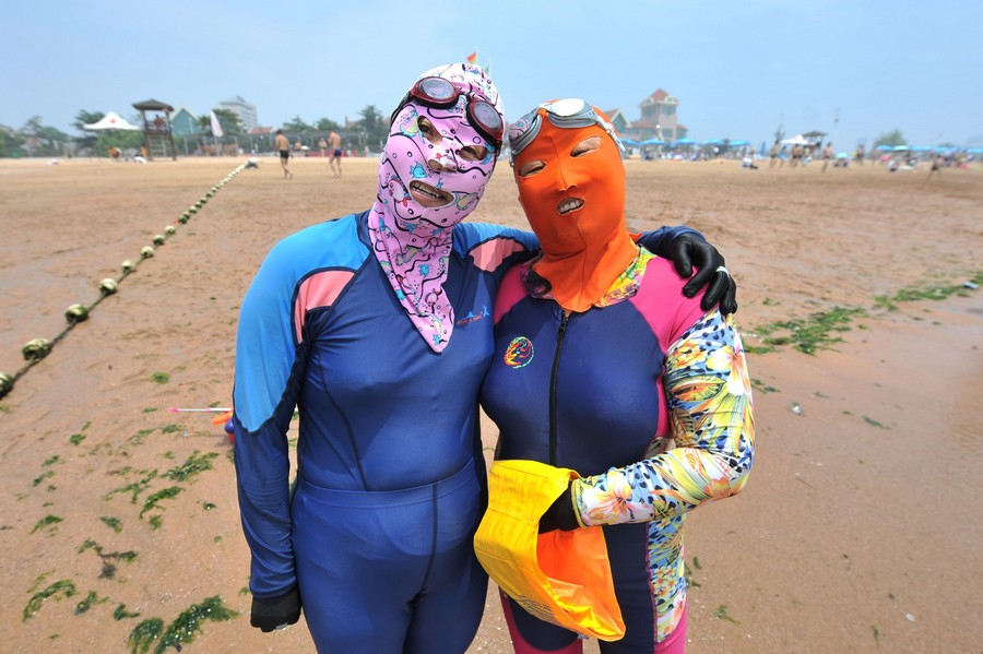 Women Wear Facekinis On Beach
