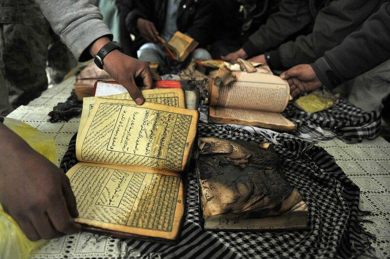 Afghan demonstrators show copies of Kora