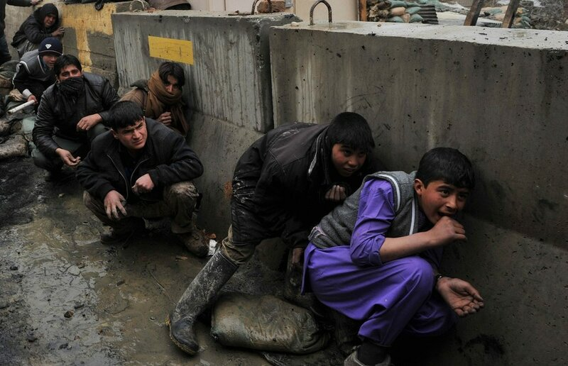 Afghan youth take cover from the rubbers