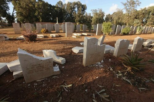 Gravestones are seen damaged by an Islamist group in protest at the burning of Koran by U.S. soldiers in Afghanistan, in Benghazi Military Cemetery