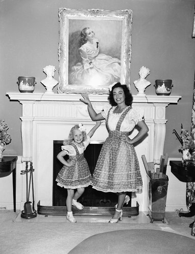 Joan Crawford And Daughter Christina By Fireplace