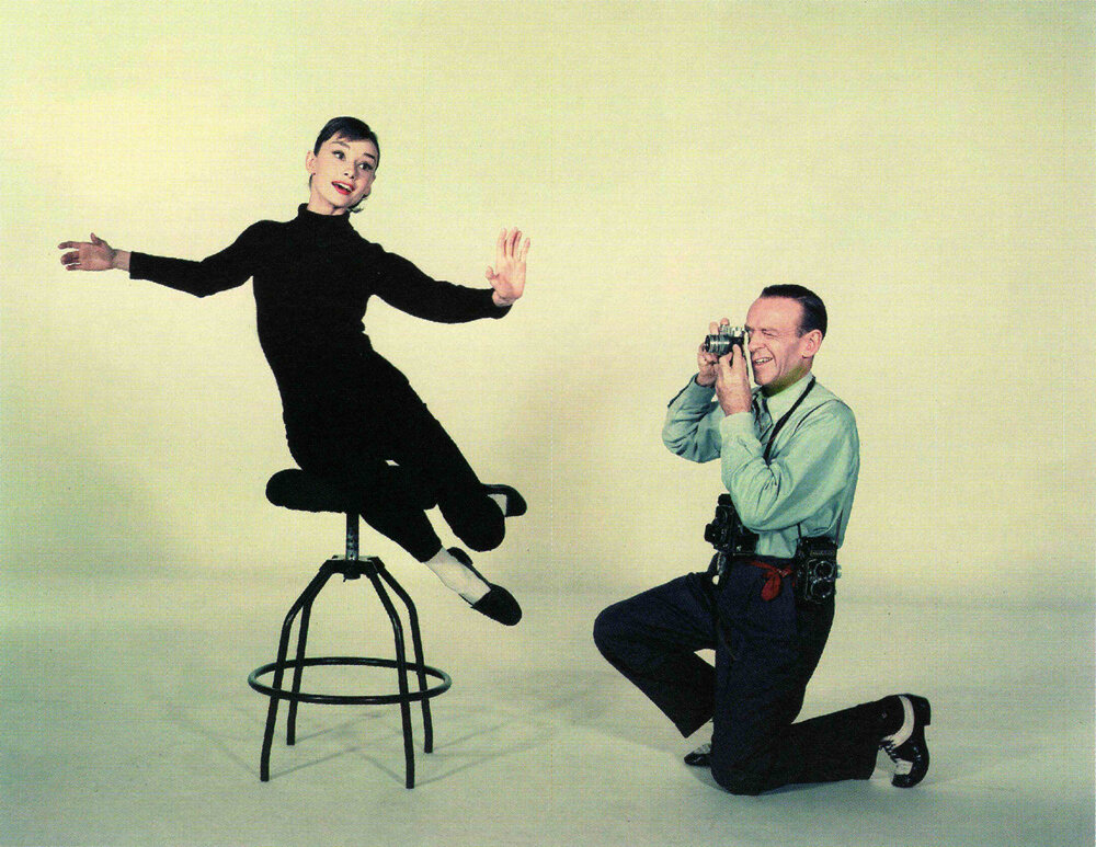 Audrey Hepburn being photographed by Fred Astaire