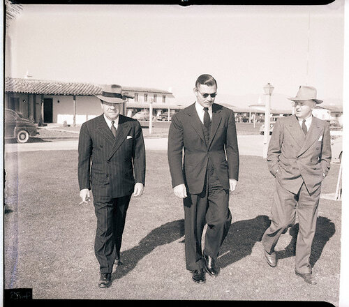Clark Gable and Two Men Walk from Hotel