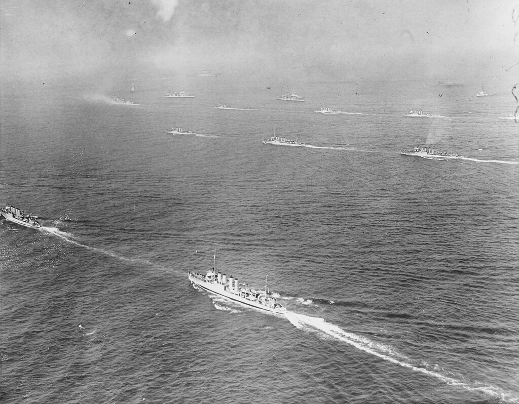 View from the air showing warships of the entire fleet proceeding in the direction of the Ambrose Lightship where they went to be reviewed by the president. Thu, May 31, 1934