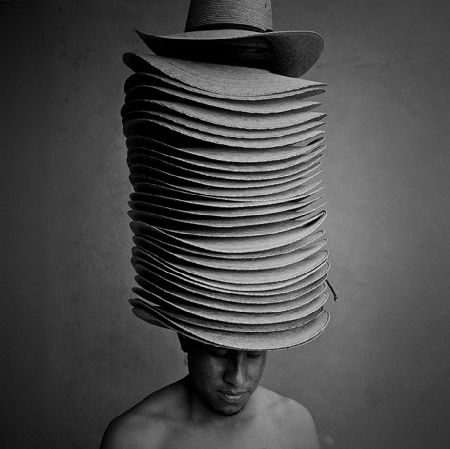 14. Продавец шляп. (Russell Monk)