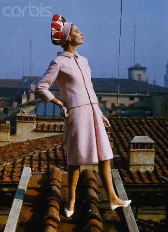 Female Model Posing in Pink Suit on Rooftop