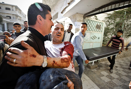 A man is carried in for medical treatment, Khan Sheyhoun