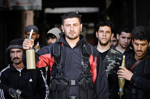 Rebels of the Free Syrian Army show off their Molotov cocktails