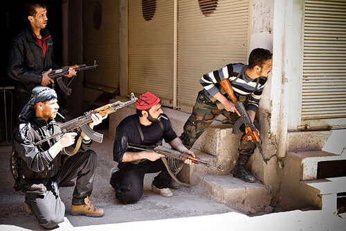 Rebels of the Free Syrian Army prepare to engage government tanks