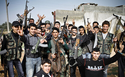 Young members of the Free Syrian Army show off their weapons, araquib city