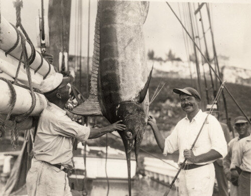Ernest Hemingway admires a catch aboard the Pilar, 1934