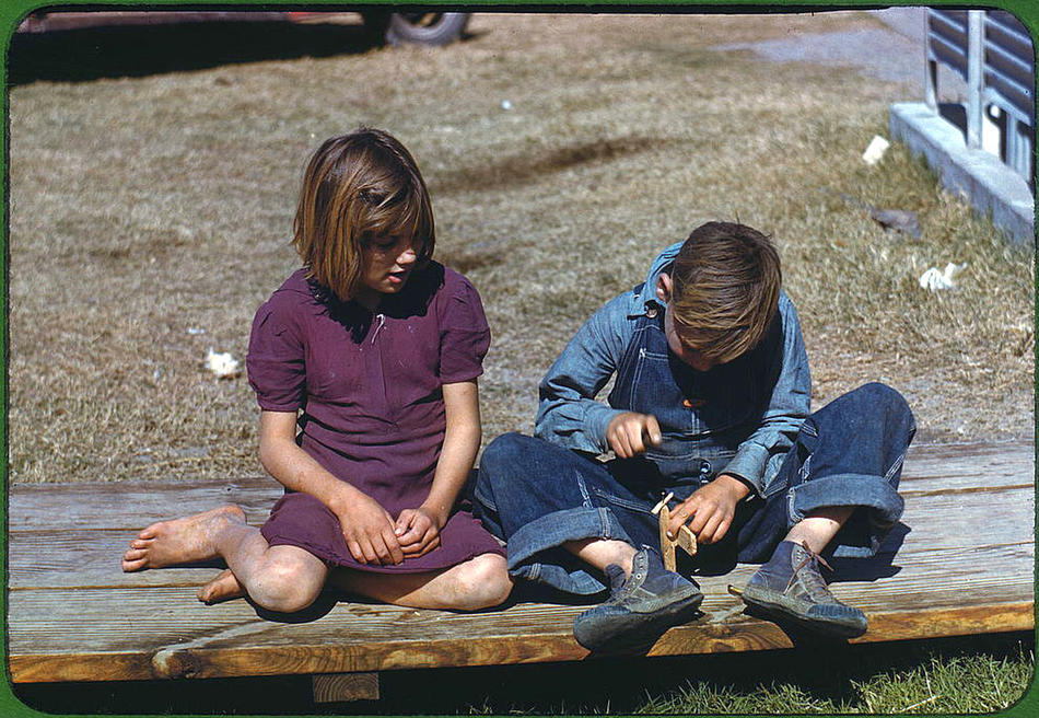 Boy building a model airplane as girl watches. Robstown, Texas, January 1942. Reproduction from color slide. Photo by Arthur Rothstein. Prints and Photographs Division, Library of Congress