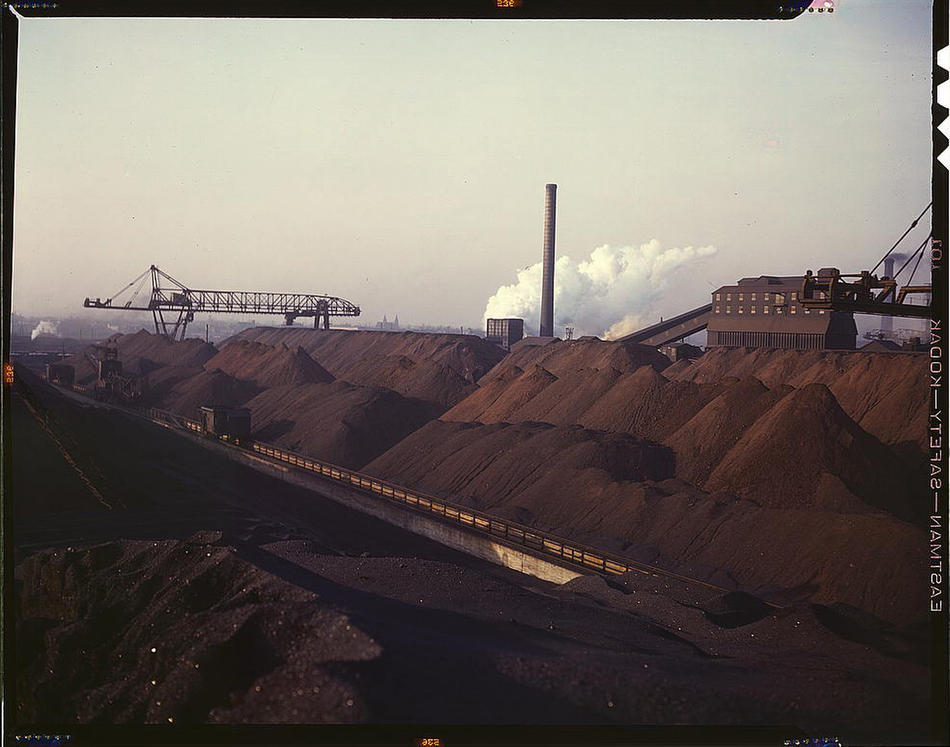 Hanna furnaces of the Great Lakes Steel Corporation, stock pile of coal and iron ore. Detroit, Michigan, November 1942. Reproduction from color slide. Photo by Arthur Siegel. Prints and Photographs Division, Library of Congress
