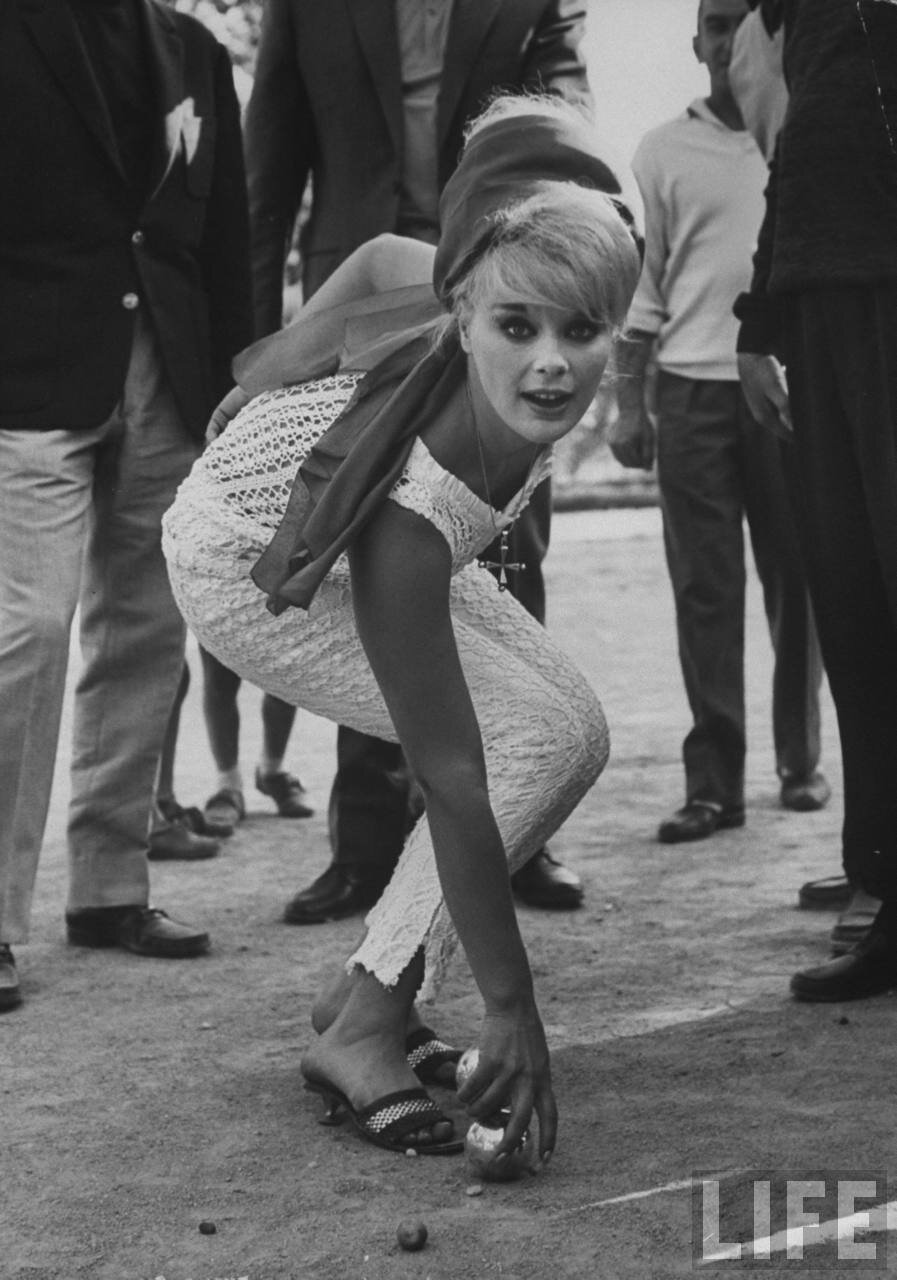 Actress Elke Sommer playing petanque