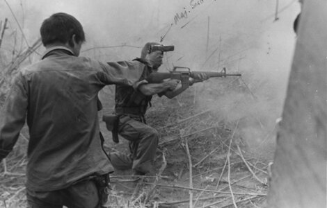 2 men in the heat of battle were photographed firing their guns