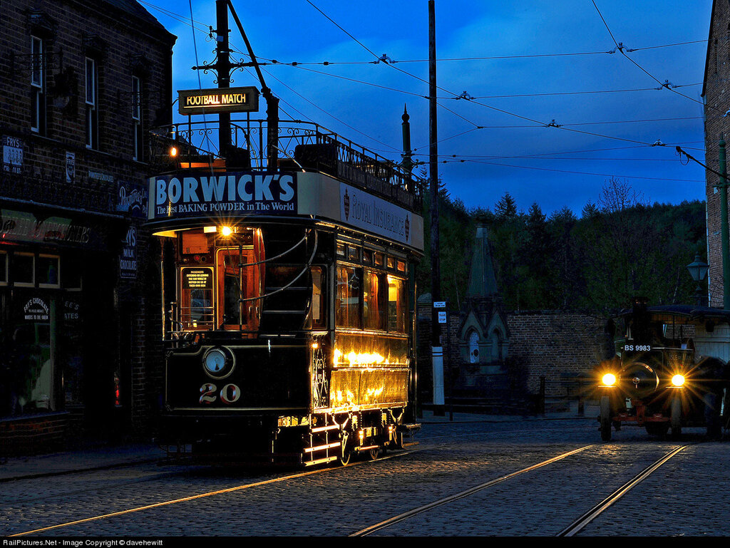 A waiting tram is highlighted by the lights of the oncoming steam lorry. Beamish museum, Durham, United Kingdom, April 14, 2012