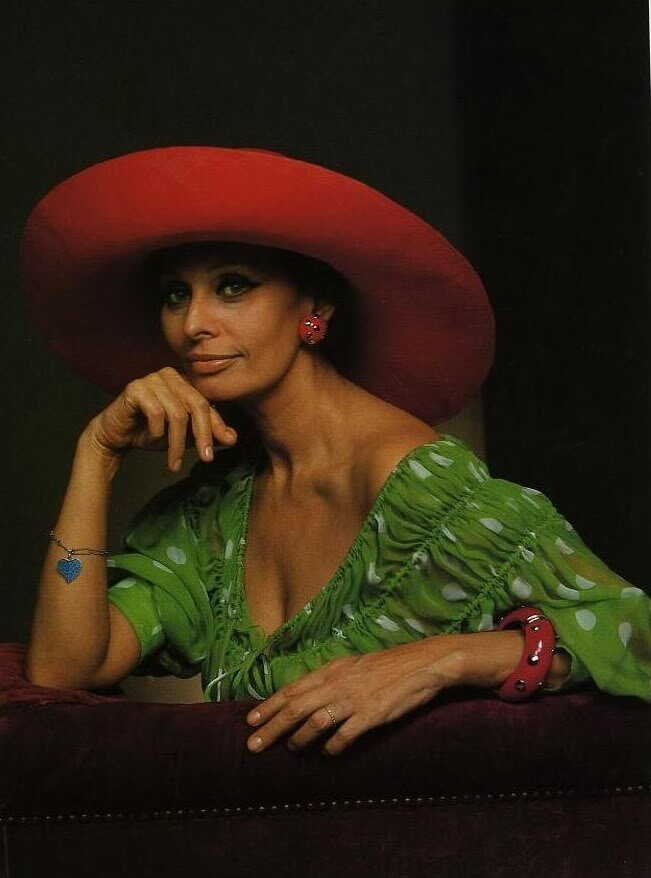 Sophia Loren, Red Hat, Green with White polka Dot blouse, Red Wine colored Couch, Yousuf Karsh, red bangle bracelet...