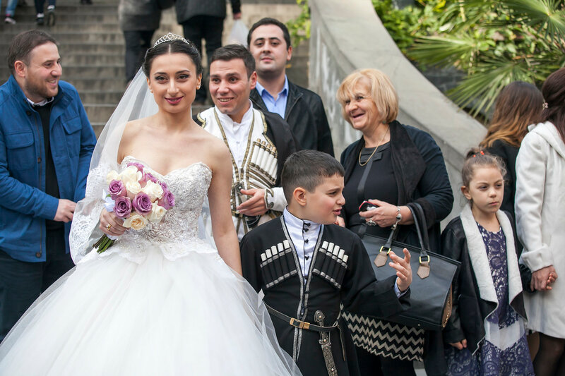 Bride poses photo in front of The Sioni Cathedral is a Georgian Orthodox cathedral