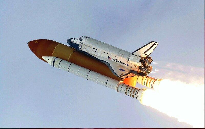 Американская многоразовая космическая система Space Shuttle в полете. sts135-s-155.jpg