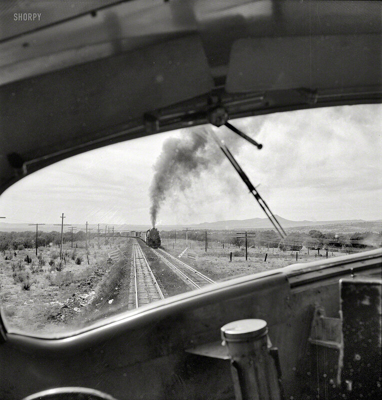 March 1943. Ash Fork, Arizona (vicinity). Passing an eastbound freight on the Atchison, Topeka & Santa Fe Railroad between Winslow and Seligman