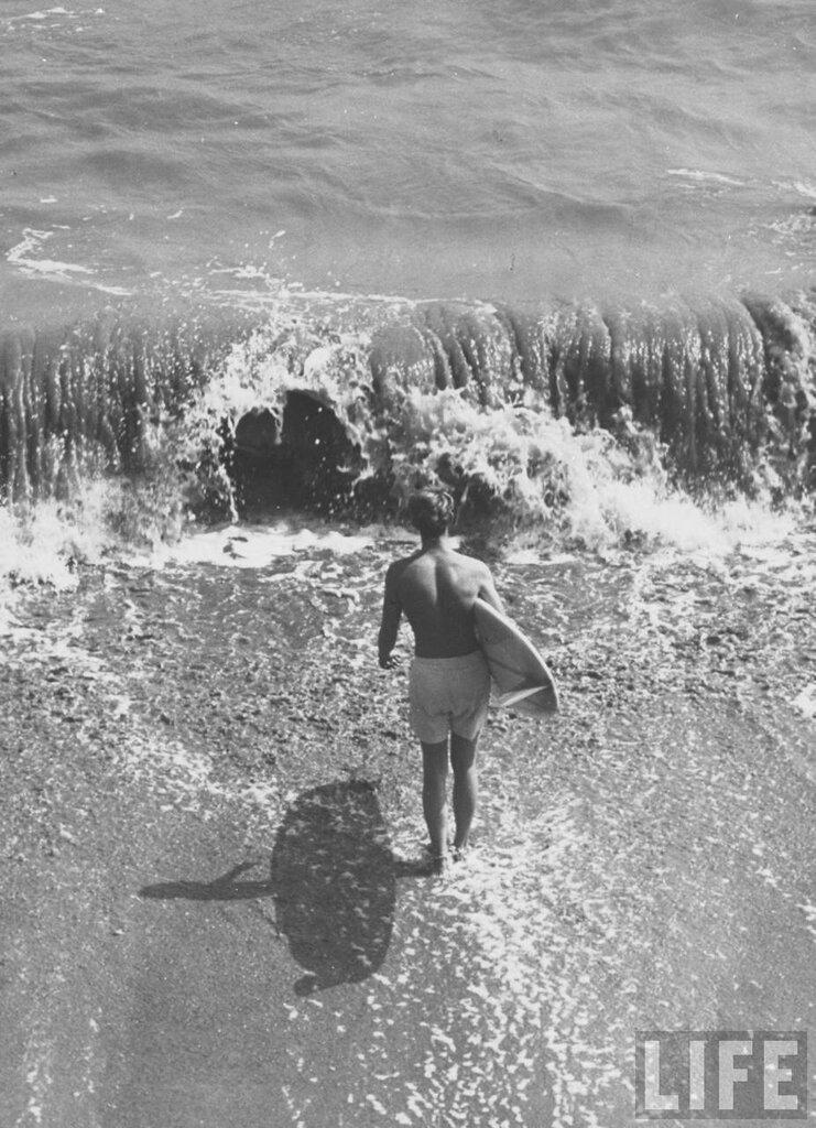 Malibu, CA, US Surf riders surfing by Allan Grant 1961