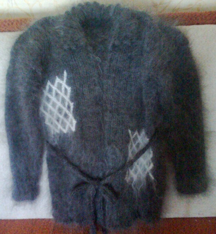 Новохопёрский пуховый платок -пушистый и теплый, словно печка, он привлекает внешней красотой и добротностью.