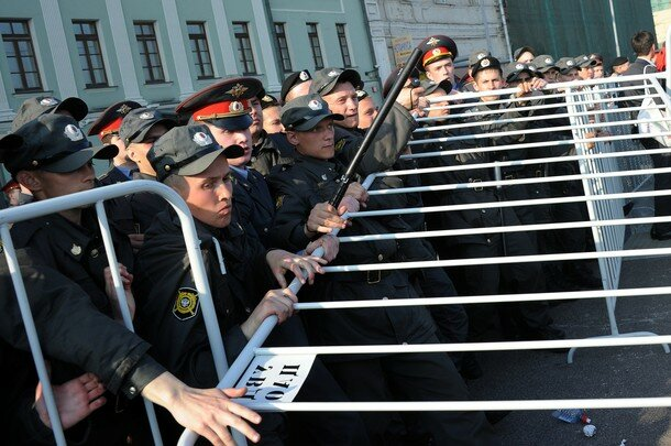 Russian police officers block a street d