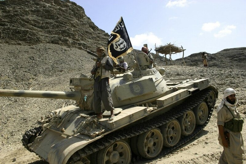 Members of Ansar al-Sharia guard a road leading to the southern Yemeni town of Jaar